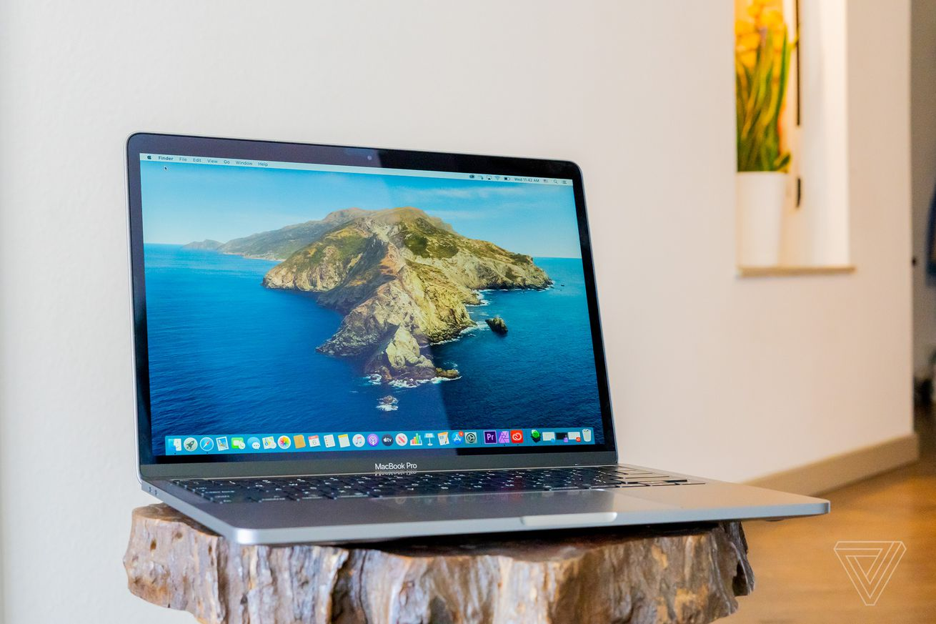 A 2020 Apple MacBook Pro 13-inch on a wooden table