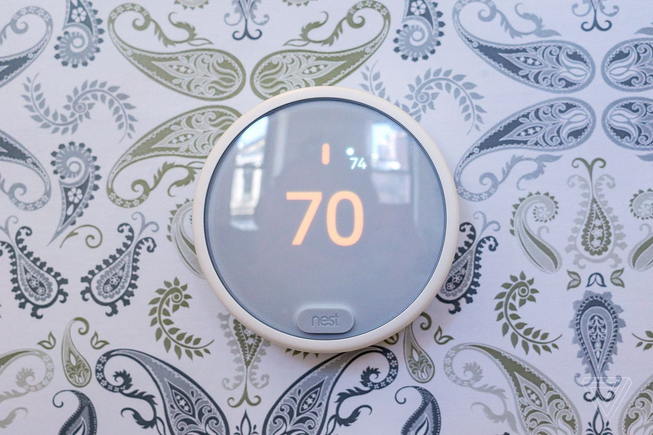 Nest E smart thermostat on wall with paisley wallpaper