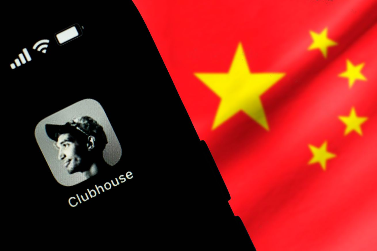 In this photo illustration, the Clubhouse logo seen displayed on a smartphone screen in front of the Chinese national flag