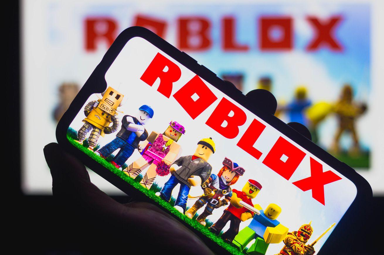 Roblox logo on a smartphone